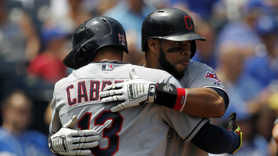 Cleveland Indians' Carlos Santana, right, hugs teammate Asdrubal Cabrera (13) at home plate after hitting a two-run home run in the fifth inning of a baseball game against the Kansas City Royals at Kauffman Stadium in Kansas City, Mo., Thursday, July 24,