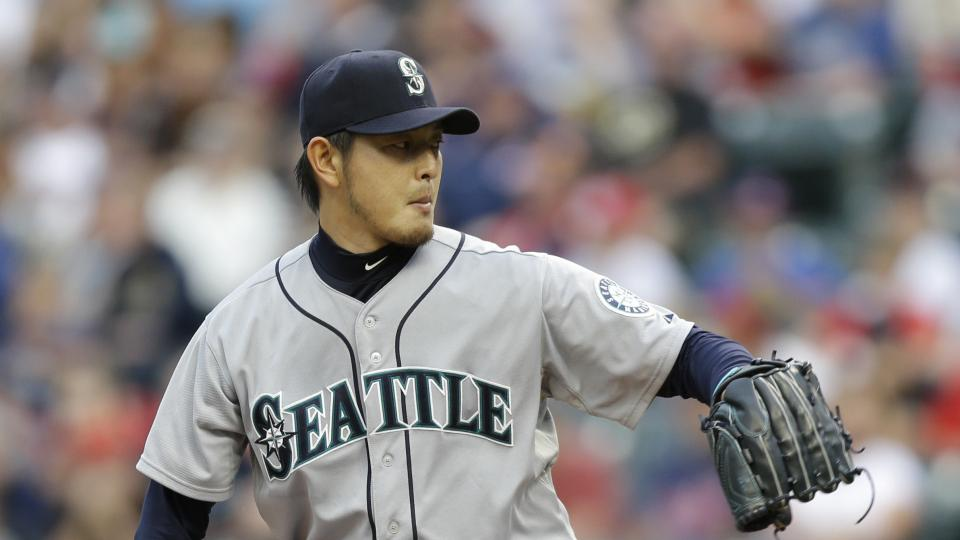 Seattle Mariners starting pitcher Hisashi Iwakuma delivers in the first inning of a baseball game against the Cleveland Indians Tuesday, July 29, 2014, in Cleveland. (AP Photo/Tony Dejak)