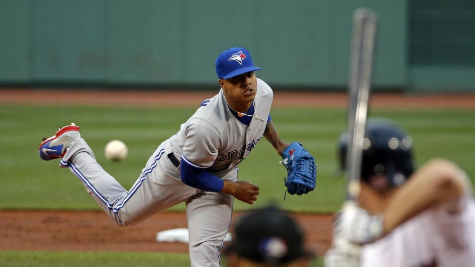 Toronto Blue Jays starting pitcher Marcus Stroman delivers to the Boston Red Sox during the first inning of a baseball game at Fenway Park in Boston, Tuesday, July 29, 2014. (AP Photo/Elise Amendola)