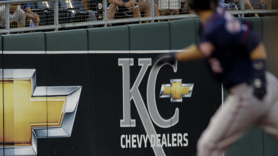 Kansas City Royals left fielder Alex Gordon catches a fly ball hit by Minnesota Twins' Chris Parmelee during the third inning of a baseball game Tuesday, July 29, 2014, in Kansas City, Mo. (AP Photo/Charlie Riedel)
