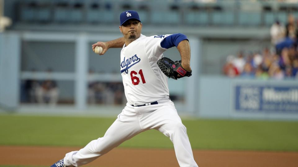 Los Angeles Dodgers starting pitcher Josh Beckett throws against the Atlanta Braves during the first inning of a baseball game on Tuesday, July 29, 2014, in Los Angeles. (AP Photo/Jae C. Hong)