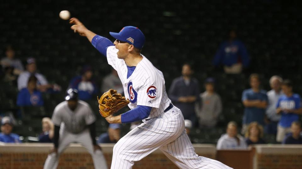 Chicago Cubs back up catcher John Baker, pitches in relief during the 16th inning of a baseball game against the Colorado Rockies, early Wednesday, July 30, 2014, in Chicago. Baker score the winning run off a sacrifice fly by Starlin Castro, in the bottom