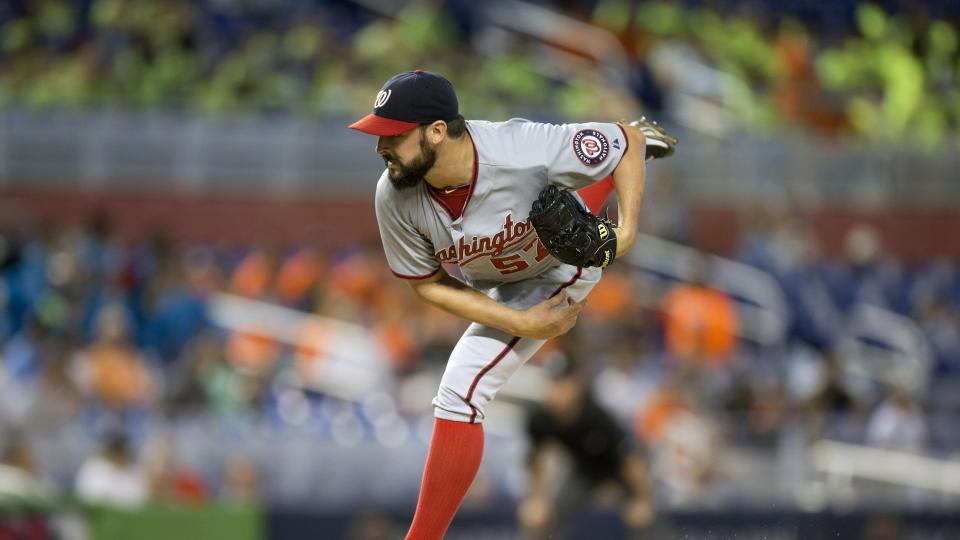 Washington Nationals starter Tanner Roark pitches to the Miami Marlins during the first inning of a baseball game in Miami, Wednesday, July 30, 2014. (AP Photo/J Pat Carter)