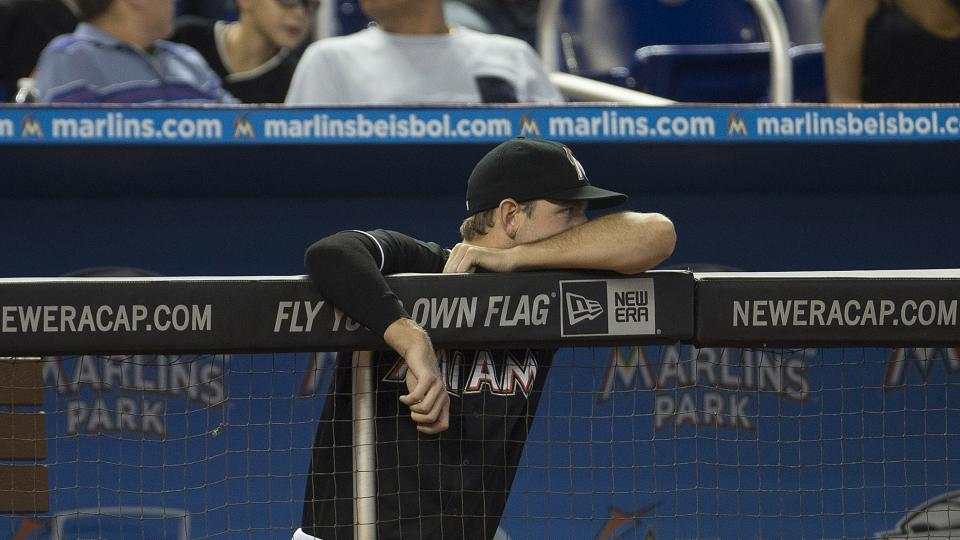 Miami Marlins' Jacob Turner watches game action against the Washington Nationals during the eighth inning of a baseball game in Miami, Wednesday, July 30, 2014. The Nationals won 4-3. (AP Photo/J Pat Carter)