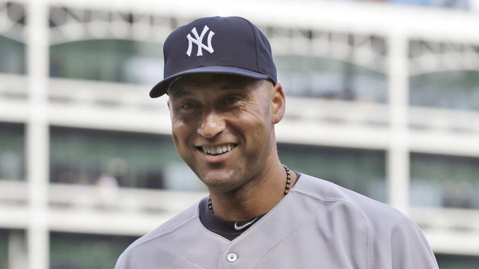 New York Yankees Derek Jeter poses with boots presented during a ceremony honoring him before a baseball game against the Texas Rangers Wednesday, July 30, 2014, in Arlington, Texas. (AP Photo/LM Otero)