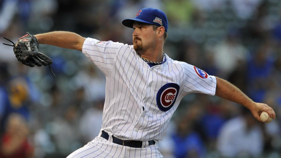 Chicago Cubs starter Travis Wood delivers a pitch during the first inning of a baseball game agains the Colorado Rockies in Chicago, Wednesday, July 30, 2014. (AP Photo/Paul Beaty)
