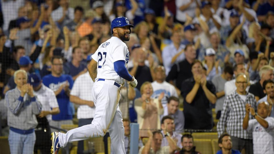 Los Angeles Dodgers' Matt Kemp looks toward first after scoring on a single by Juan Uribe during the eighth inning of a baseball game against the Atlanta Braves, Wednesday, July 30, 2014, in Los Angeles. (AP Photo/Mark J. Terrill)