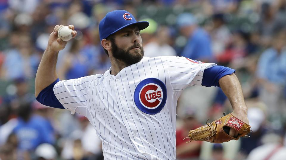 Chicago Cubs starter Jake Arrieta throws against the Colorado Rockies during the first inning of a baseball game in Chicago, Thursday, July 31, 2014. (AP Photo/Nam Y. Huh)