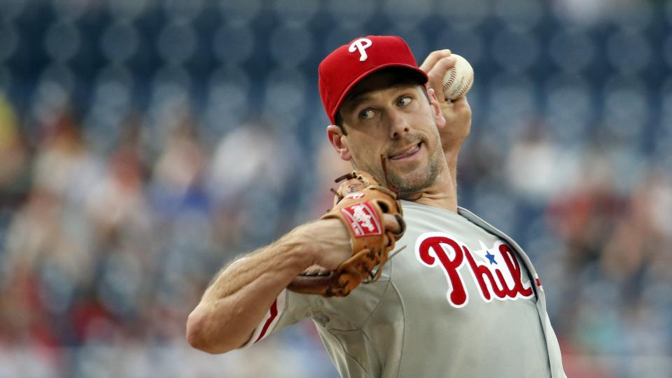 Philadelphia Phillies starting pitcher Cliff Lee throws during the first inning of a baseball game against the Washington Nationals at Nationals Park Thursday, July 31, 2014, in Washington. (AP Photo/Alex Brandon)