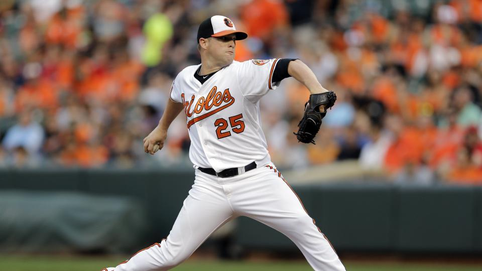 Baltimore Orioles starting pitcher Bud Norris throws to the Los Angeles Angels in the first inning of a baseball game, Thursday, July 31, 2014, in Baltimore. (AP Photo/Patrick Semansky)