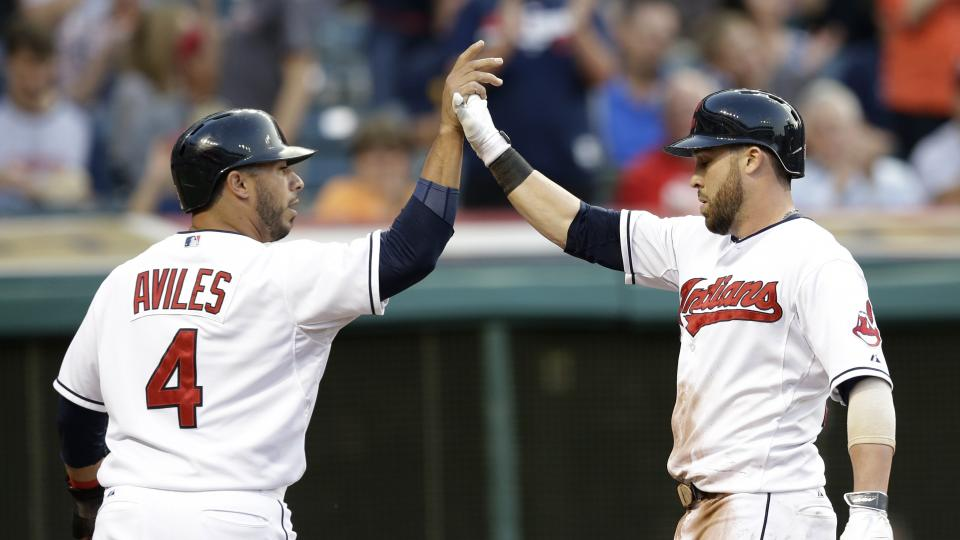 Cleveland Indians' Jason Kipnis, right, is congratulated by Mike Aviles after Kipnis hit a two-run home run off Seattle Mariners starting pitcher Chris Young in the third inning of a baseball game Thursday, July 31, 2014, in Cleveland. Aviles scored on th