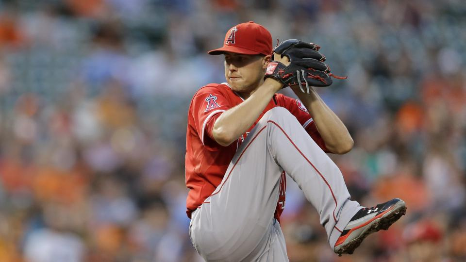 Los Angeles Angels starting pitcher Tyler Skaggs winds up for a pitch to the Baltimore Orioles in the third inning of a baseball game, Thursday, July 31, 2014, in Baltimore. (AP Photo/Patrick Semansky)