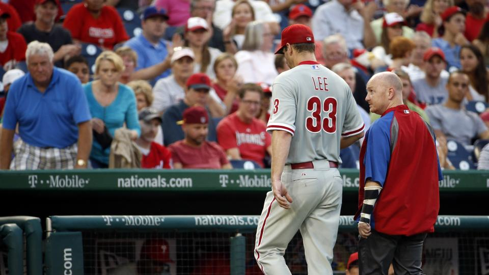 Philadelphia Phillies starting pitcher Cliff Lee (33) walks to the dugout during the third inning of a baseball game against the Washington Nationals at Nationals Park Thursday, July 31, 2014, in Washington. The Phillies announced that Lee had a recurrenc