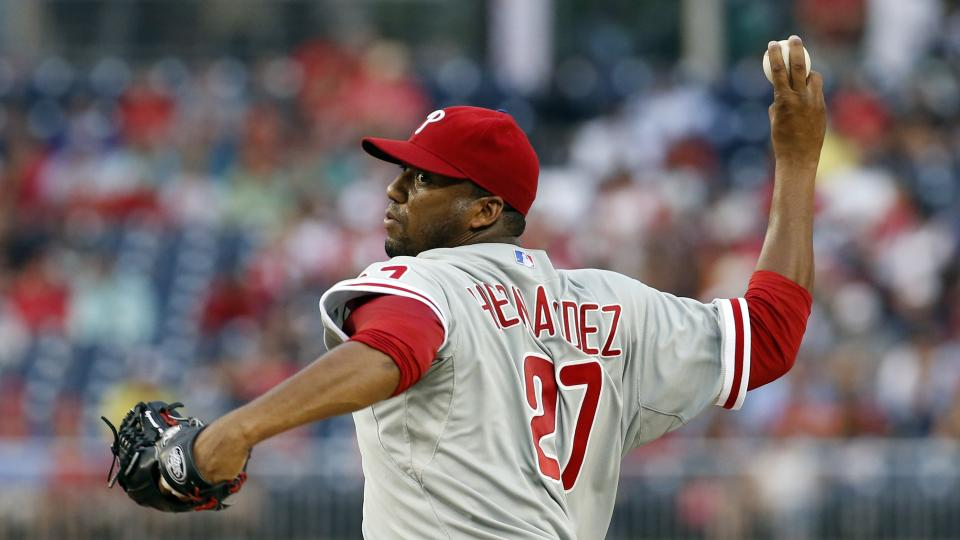 Philadelphia Phillies starting pitcher Roberto Hernandez throws during the first inning of a baseball game against the Washington Nationals at Nationals Park Friday, Aug. 1, 2014, in Washington. (AP Photo/Alex Brandon)