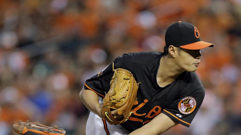 Baltimore Orioles starting pitcher Wei-Yin Chen, of Taiwan, throws to the Seattle Mariners in the fourth inning of a baseball game, Friday, Aug. 1, 2014, in Baltimore. (AP Photo/Patrick Semansky)