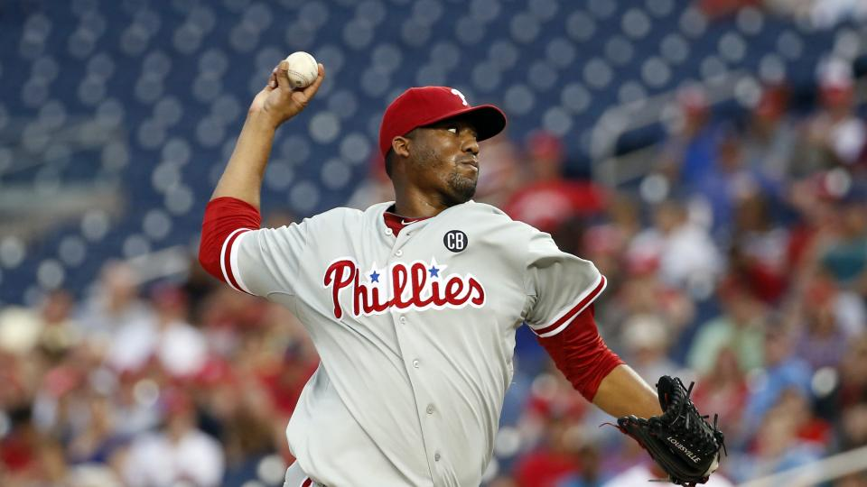 Philadelphia Phillies starting pitcher Roberto Hernandez throws during the second inning of a baseball game against the Washington Nationals at Nationals Park, Friday, Aug. 1, 2014, in Washington. (AP Photo/Alex Brandon)