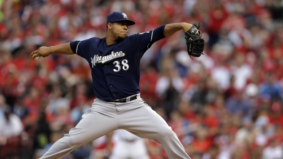 Milwaukee Brewers starting pitcher Wily Peralta throws during the first inning of a baseball game against the St. Louis Cardinals on Friday, Aug. 1, 2014, in St. Louis. (AP Photo/Jeff Roberson)