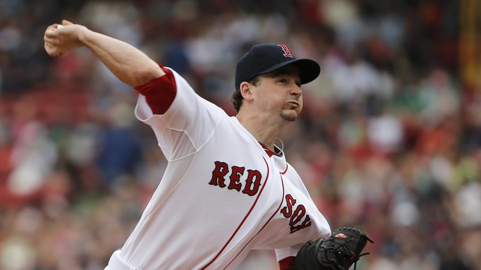 Boston Red Sox starting pitcher Allen Webster delivers a pitch against the New York Yankees during the first inning of a baseball game at Fenway Park in Boston Saturday, Aug. 2, 2014. (AP Photo/Winslow Townson)