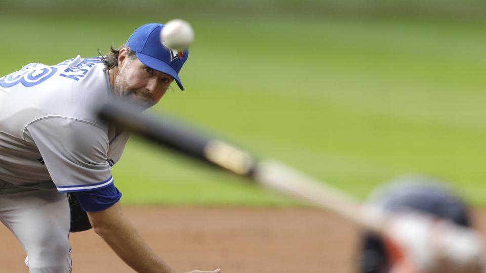 Toronto Blue Jays' R.A. Dickey delivers a pitch to Houston Astros' Jose Altuve in the first inning of a baseball game Saturday, Aug. 2, 2014, in Houston. (AP Photo/Pat Sullivan)
