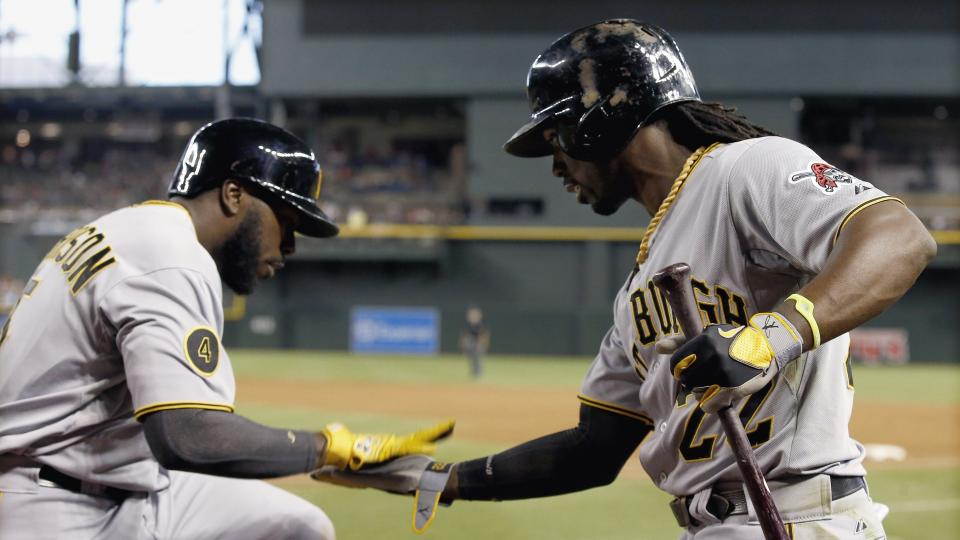 Pittsburgh Pirates' Josh Harrison, left, celebrates his home run against the Arizona Diamondbacks with teammate Andrew McCutchen, right, during the third inning of a baseball game on Saturday, Aug. 2, 2014, in Phoenix. (AP Photo/Ross D. Franklin)