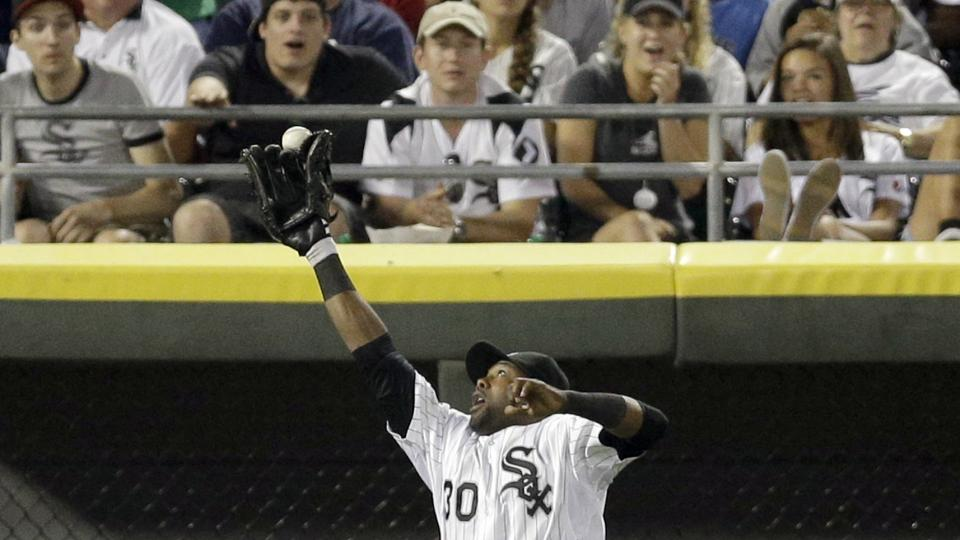 Chicago White Sox left fielder Alejandro De Aza can't make the play on a double hit by Minnesota Twins' Oswaldo Arcia during the eighth inning of a baseball game in Chicago, Saturday, Aug. 2, 2014. (AP Photo/Nam Y. Huh)