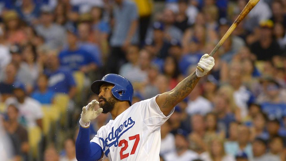 Los Angeles Dodgers' Matt Kemp hits a two-run home run during the fourth inning of a baseball game against the Chicago Cubs, Saturday, Aug. 2, 2014, in Los Angeles. (AP Photo/Mark J. Terrill)