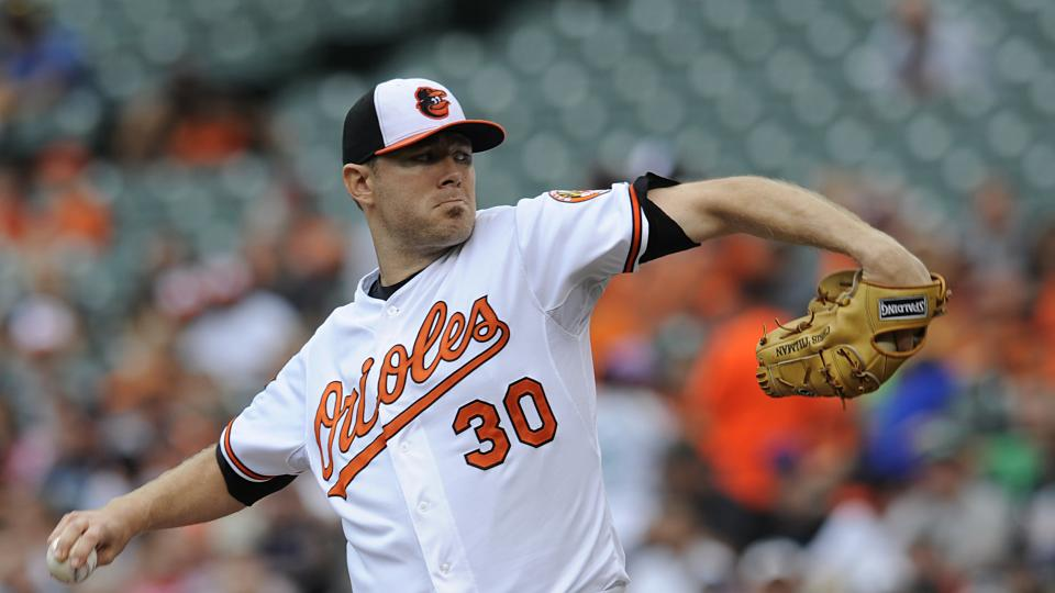 Baltimore Orioles starting pitcher Chris Tillman delivers against the Seattle Mariners in the first inning of a baseball game Sunday, Aug.  3, 2014, in Baltimore.(AP Photo/Gail Burton)