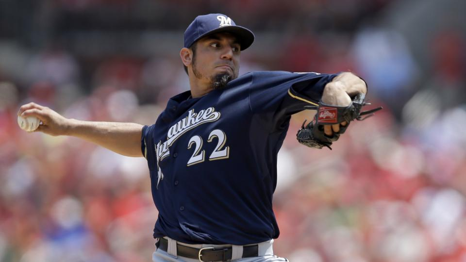 Milwaukee Brewers starting pitcher Matt Garza throws during the first inning of a baseball game against the St. Louis Cardinals Sunday, Aug. 3, 2014, in St. Louis. (AP Photo/Jeff Roberson)