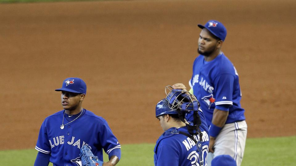 Toronto Blue Jays starting pitcher Marcus Stroman, left, looks away as manager John Gibbons, right, catcher Dioner Navarro (30) and Juan Francisco approach him after he gave up two runs in the fourth inning of a baseball game against the Houston Astros, S
