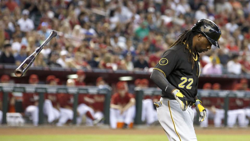 Pittsburgh Pirates' Andrew McCutchen throws his bat away after getting walked by Arizona Diamondbacks' Trevor Cahill during the third inning of a baseball game on Sunday, Aug. 3, 2014, in Phoenix. (AP Photo/Ross D. Franklin)