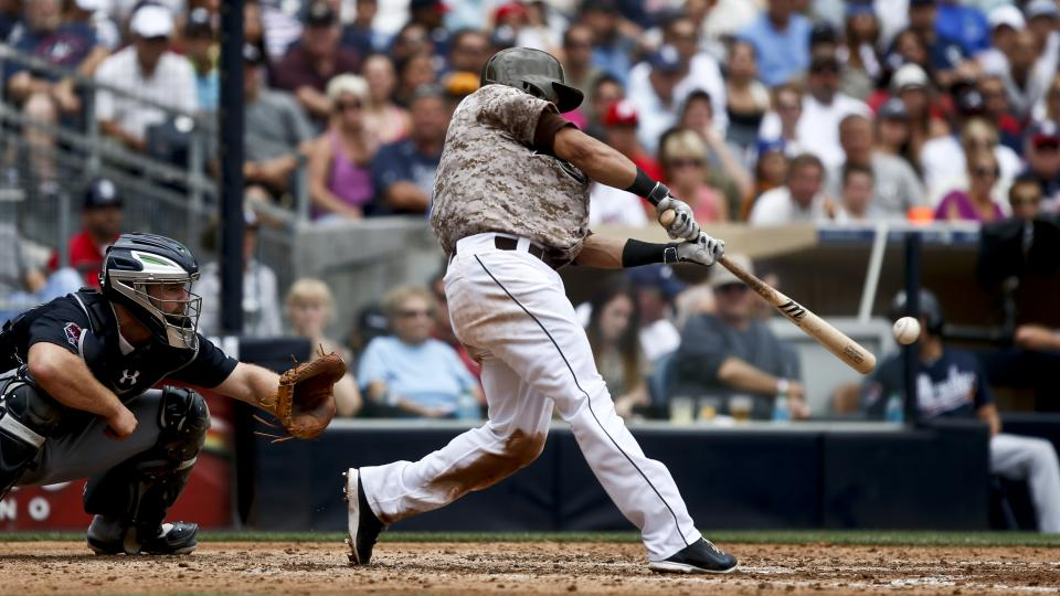 San Diego Padres' Everth Cabrera connects on a hard line drive that was caught in right field but allowed a run to score from third against the Atlanta Braves in the fourth inning of a baseball game Sunday, Aug. 3, 2014, in San Diego.  (AP Photo/Lenny Ign