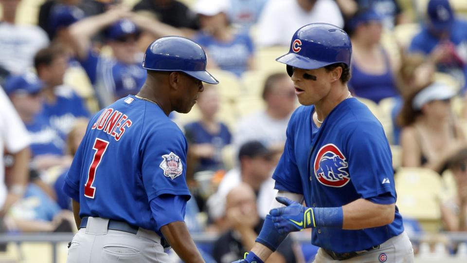 Chicago Cubs' Chris Coghlan, right, is congratulated by third base coach Gary Jones (1) after he hits a two-run home run in the fifth inning of a baseball game against the Los Angeles Dodgers on Sunday, Aug. 3, 2014, in Los Angeles. (AP Photo/Alex Gallard