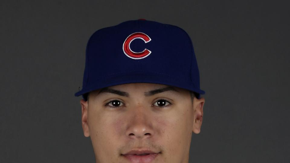 This is a 2013 photo of Javier Baez of the Chicago Cubs baseball team. This image reflects the Cubs active roster as of Monday, Feb. 18, 2013. (AP Photo/Morry Gash)