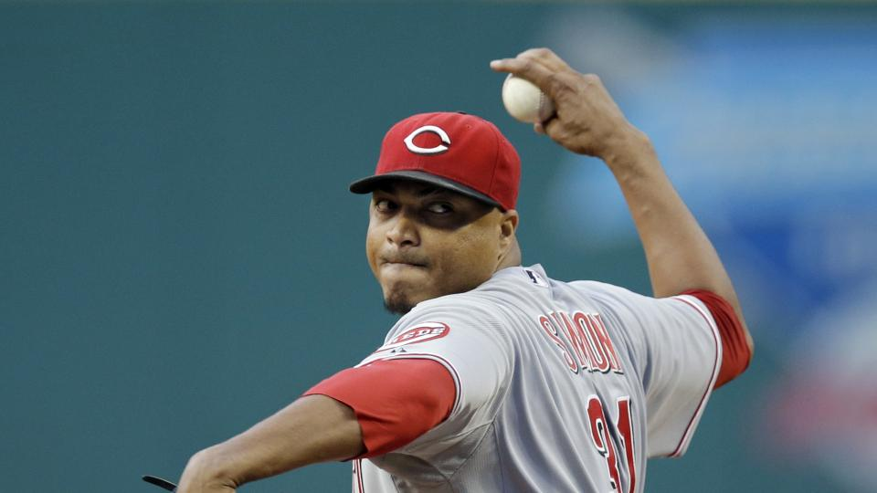 Cincinnati Reds starting pitcher Alfredo Simon delivers against the Cleveland Indians in the first inning of a baseball game Monday, Aug. 4, 2014, in Cleveland. (AP Photo/Mark Duncan)