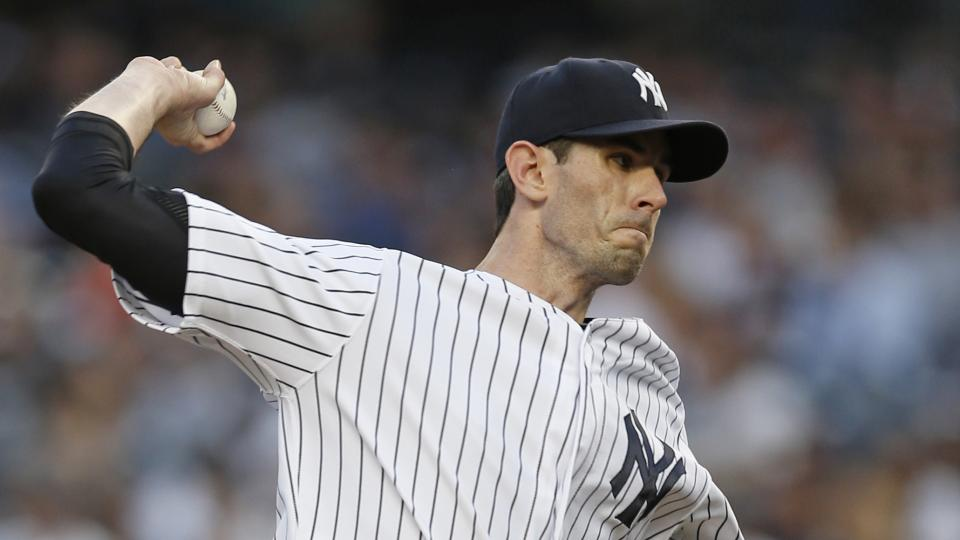 New York Yankees starting pitcher Brandon McCarthy delivers in the first inning of a baseball game against the Detroit Tigers at Yankee Stadium in New York, Monday, Aug. 4, 2014.  (AP Photo/Kathy Willens)