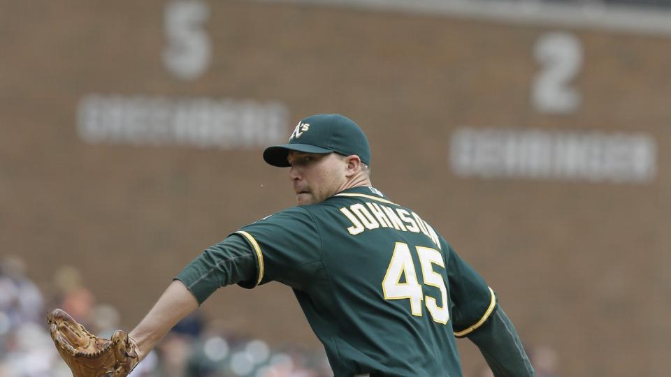 Oakland Athletics relief pitcher Jim Johnson throws during the sixth inning of a baseball game against the Detroit Tigers in Detroit, Wednesday, July 2, 2014. (AP Photo/Carlos Osorio)