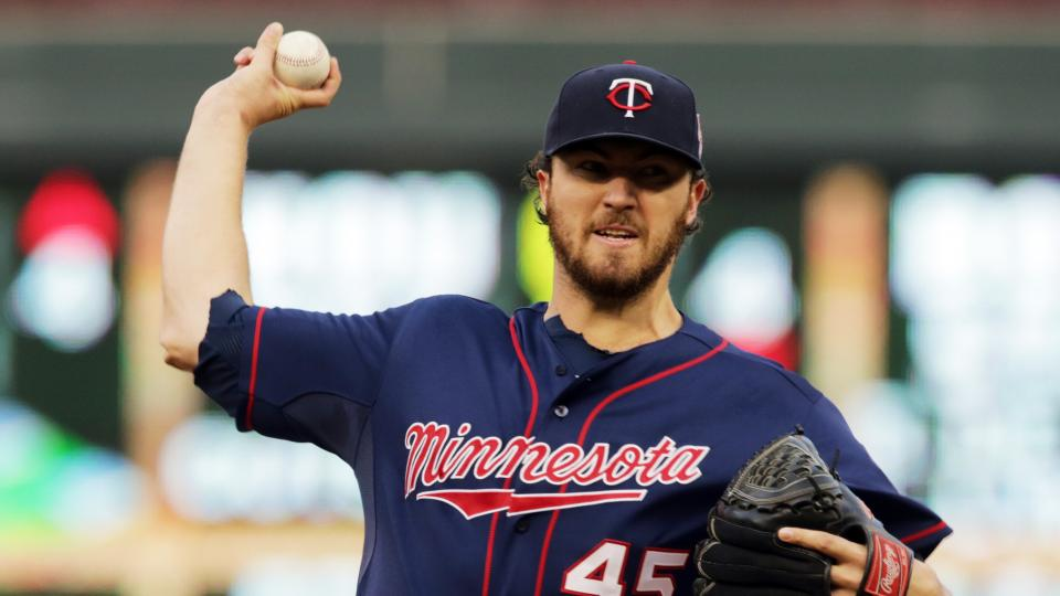Minnesota Twins pitcher Phil Hughes throws against the San Diego Padres in the first inning of a baseball game, Tuesday, Aug. 5, 2014, in Minneapolis. (AP Photo/Jim Mone)