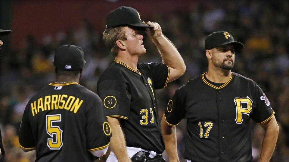 Pittsburgh Pirates relief pitcher Justin Wilson, center, waits with teammates Josh Harrison (5) and Gaby Sanchez (17) before being removed from the baseball game by manager Clint Hurdle during the eighth inning against the Miami Marlins in Pittsburgh Tues