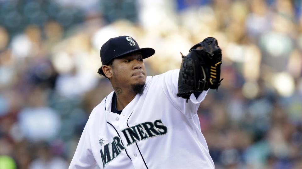 Seattle Mariners starting pitcher Felix Hernandez throws against the Atlanta Braves in the first inning of a baseball game Tuesday, Aug. 5, 2014, in Seattle. (AP Photo/Elaine Thompson)