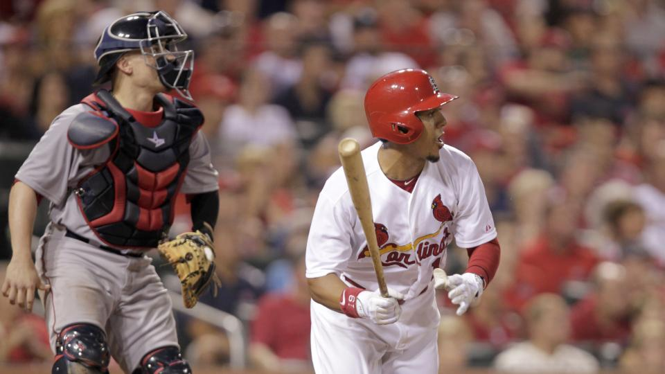 St. Louis Cardinals' Jon Jay (19) follows through on an RBI single in front of Boston Red Sox catcher Christian Vazquez during the eighth inning of a baseball game, Tuesday, Aug. 5, 2014, in St. Louis. The Cardinals beat the Red Sox 3-2. (AP Photo/Tom Gan