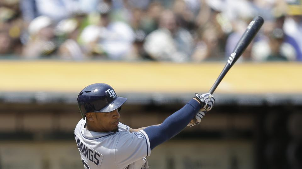Tampa Bay Rays' Desmond Jennings swings for a two run single off Oakland Athletics' Sonny Gray in the fifth inning of a baseball game Wednesday, Aug. 6, 2014, in Oakland, Calif. (AP Photo/Ben Margot)