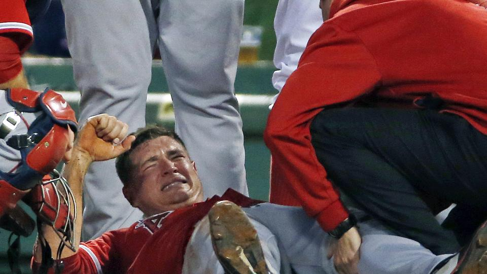 Los Angeles Angels starting pitcher Garrett Richards grimaces as he is attended to on the field after an injury during the second inning of a baseball game against the Boston Red Sox at Fenway Park in Boston, Wednesday, Aug. 20, 2014. (AP Photo/Elise Amen