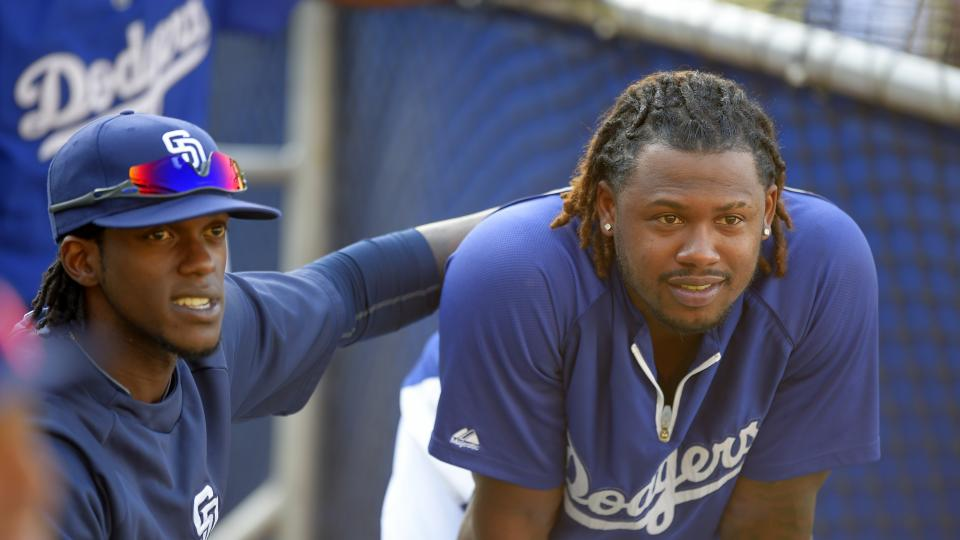 San Diego Padres' Cameron Maybin, left, talks with Los Angeles Dodgers' Hanley Ramirez during batting practice for a baseball game, Wednesday, Aug. 20, 2014, in Los Angeles.  (AP Photo/Mark J. Terrill)