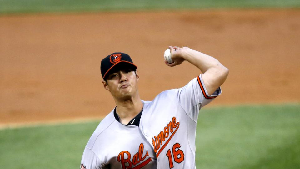 Baltimore Orioles starting pitcher Wei-Yin Chen delivers during the first inning of a baseball game against the Chicago White Sox Wednesday, Aug. 20, 2014, in Chicago. (AP Photo/Charles Rex Arbogast)