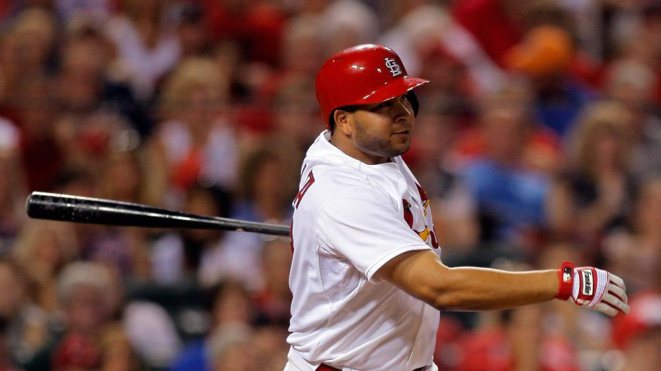 St. Louis Cardinals' Jhonny Peralta follows through on a three-run double during the fifth inning of a baseball game against the Cincinnati Reds on Wednesday, Aug. 20, 2014, in St. Louis. (AP Photo/Scott Kane)