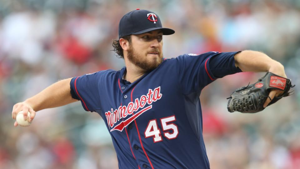 Minnesota Twins pitcher Phil Hughes throws against the Cleveland Indians  in the first inning of a baseball game, Thursday, Aug. 21, 2014, in Minneapolis. (AP Photo/Jim Mone)