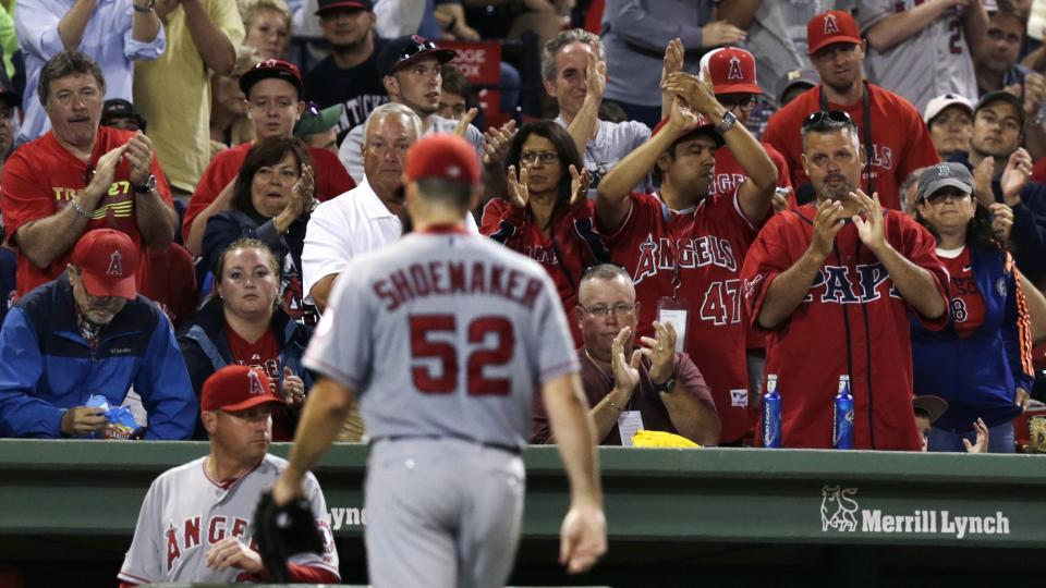Los Angeles Angels starting pitcher Matt Shoemaker (52) gets a standing ovation from Angels fans as he is taken out of a baseball game after allowing one hit during the eighth inning against the Boston Red Sox at Fenway Park in Boston, Thursday, Aug. 21,