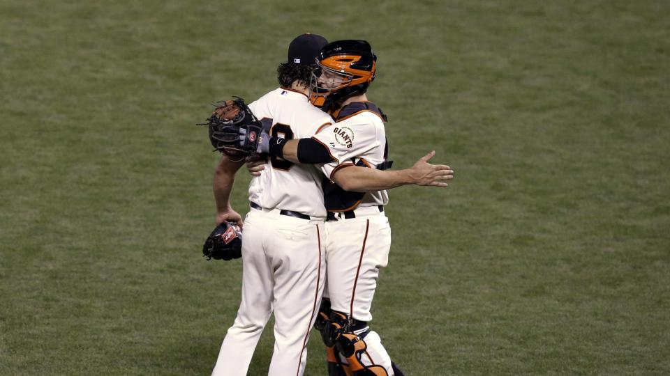 San Francisco Giants catcher Buster Posey hugs pitcher Madison Bumgarner after defeating the Kansas City Royals 5-0 in Game 5 of baseball's World Series Sunday, Oct. 26, 2014, in San Francisco. The Giants lead 3-2 in the series.  (AP Photo/Jeff Chiu)