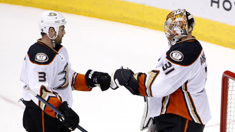 Anaheim Ducks' Frederik Andersen (31), of Denmark, celebrates a win against the Arizona Coyotes with Clayton Stoner (3) after an NHL hockey game Saturday, April 11, 2015, in Glendale, Ariz.  The Ducks defeated the Coyotes 2-1. (AP Photo/Ross D. Franklin)
