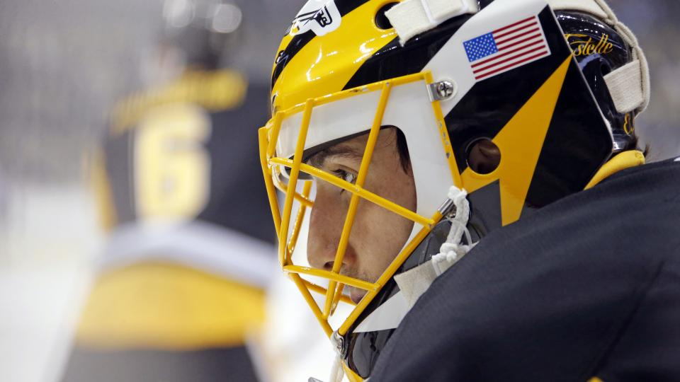 FILE - In this Dec. 18, 2014, file photo, Pittsburgh Penguins goalie Marc-Andre Fleury warms up before an NHL hockey game against the Colorado Avalance in Pittsburgh. Two years ago, Fleury briefly lost his starting job in the playoffs. Now the goaltender